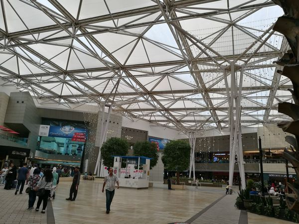 Large Group Of People Built Structure Indoors  Modern Architectural Detailshopping Retailstore