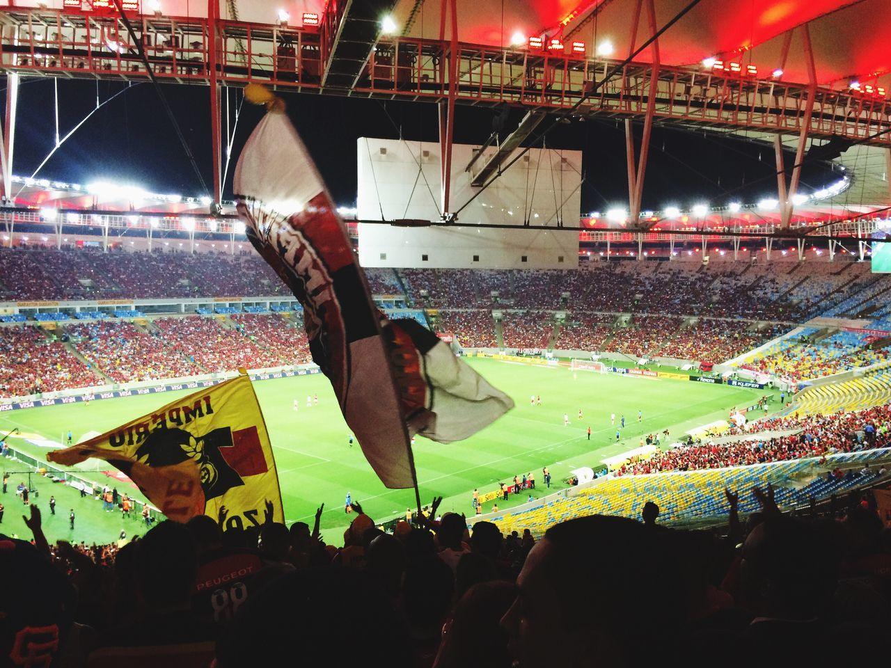 crowd, stadium, large group of people, soccer, audience, sport, spectator, fan - enthusiast, illuminated, real people, togetherness, night, flag, men, outdoors, architecture, people