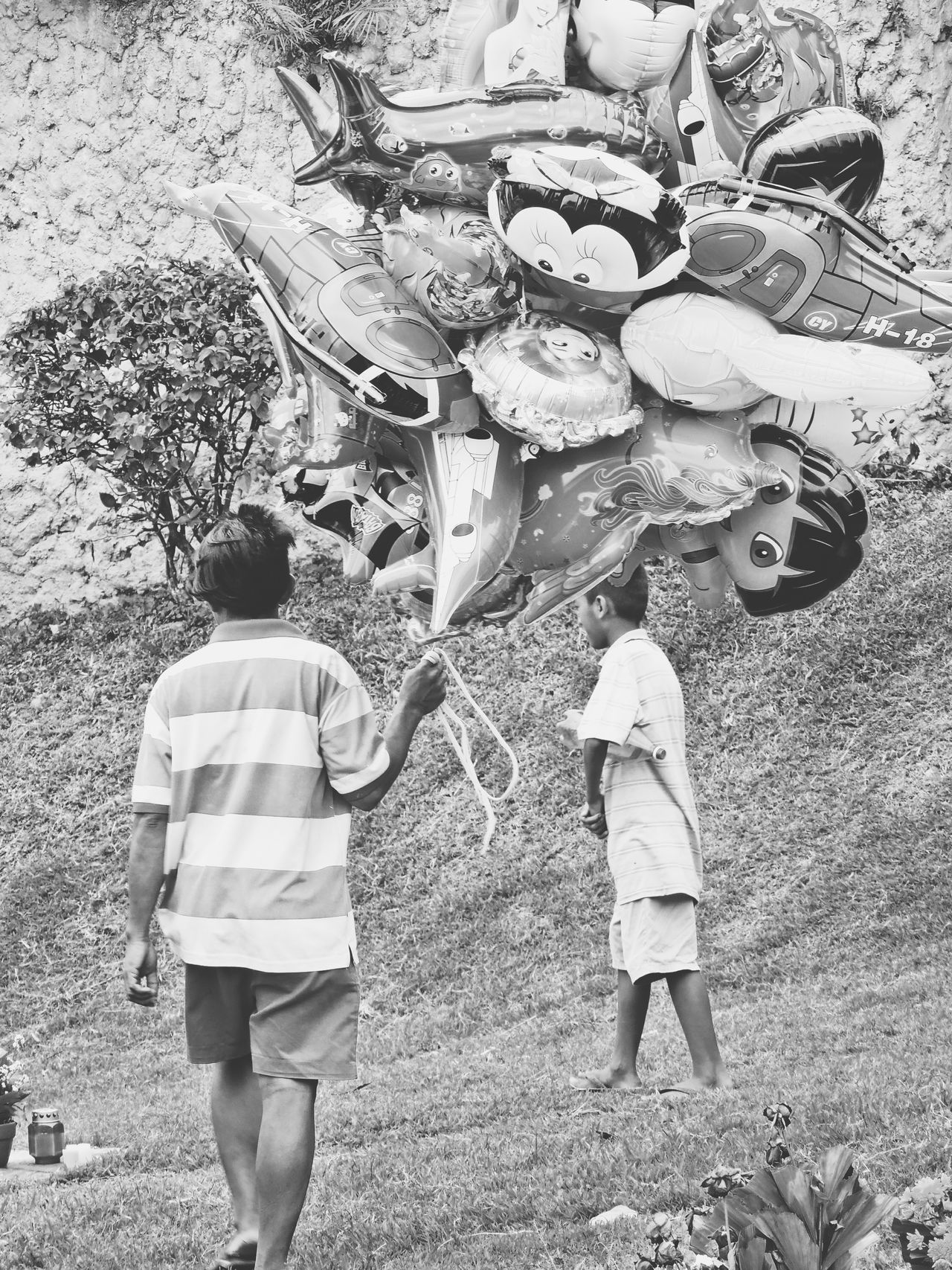 Selling balloons to kids roaming around the cemetery Global EyeEm Adventure - Philippines AllSaintsDay The Photojournalist - 2015 EyeEm Awards The Street Photographer - 2015 EyeEm Awards B&w Street Photography