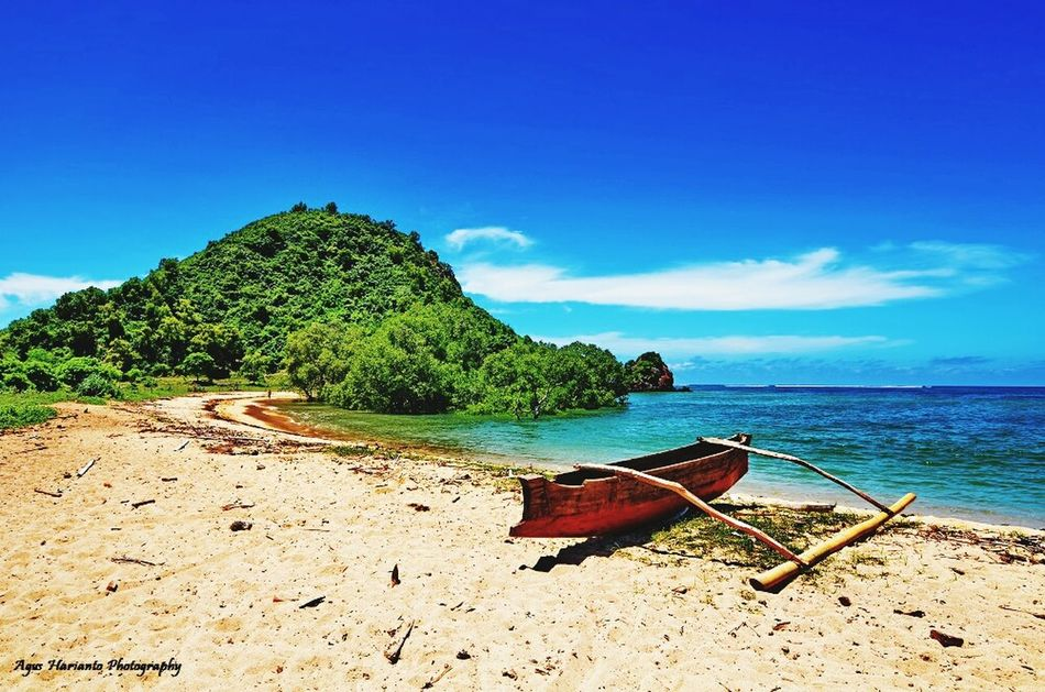 Can we keep this nature? Sea Blue Beach Sand Nature Tranquility Sky Tree Beauty In Nature Tranquil Scene Water Scenics No People Outdoors Idyllic Nautical Vessel Day Agushariantophotography Travel Destinations Tourism Lombok-Indonesia Lombok Island
