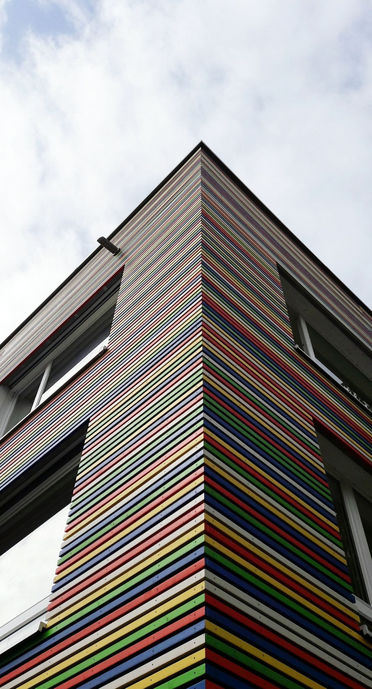 Multi Colored Architecture Built Structure Modern Outdoors Cloud - Sky Low Angle View Sky Façade Facade Building Facade Colours Architectural Feature Architectural Detail City Urban Geometry Urban Lifestyle