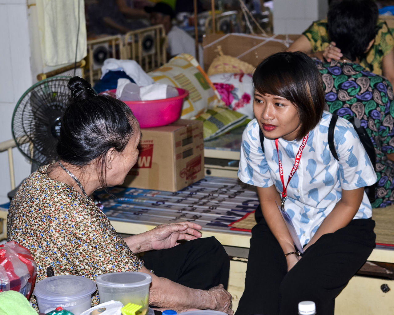 Viet Nam help portrait 2016 Adult Adults Only Business Finance And Industry Day Growth Help Portait Indoors  Indoors  Large Group Of People Lifestyles Mile Old Age Only Women People Photographer Real People Tailor Two People Viet Nam Help Volunteer Women Work Young Adult Young Women