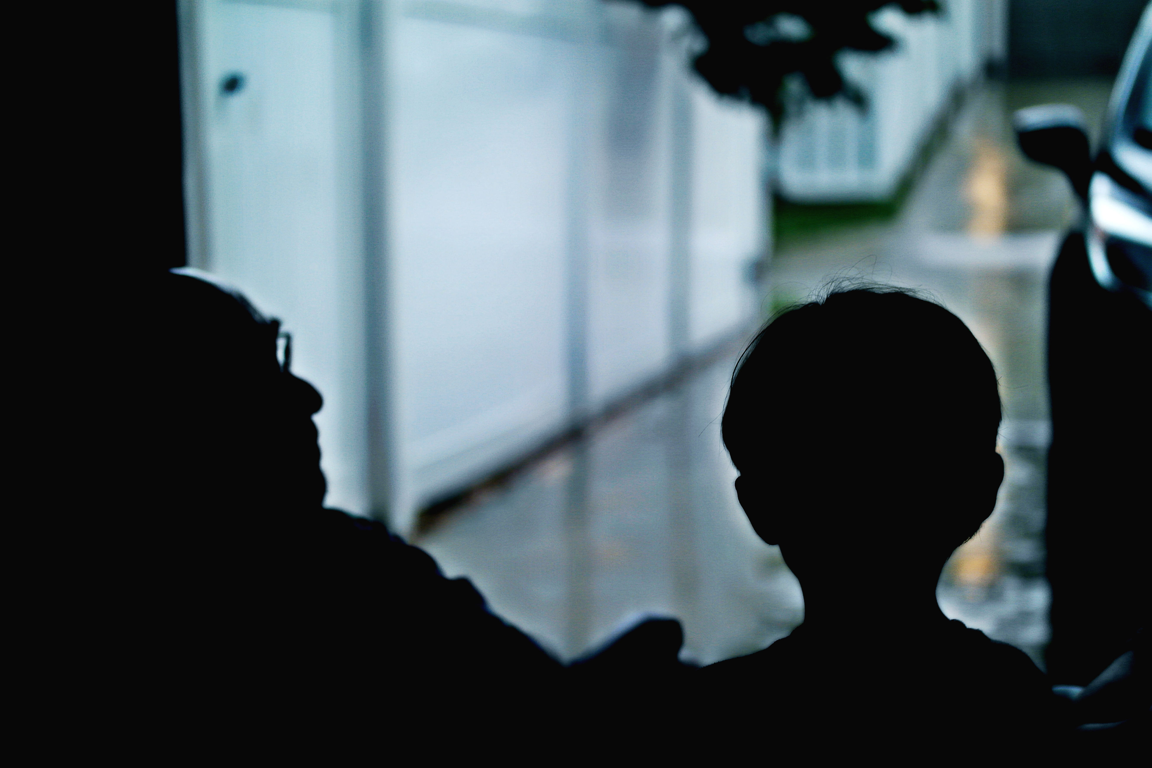 indoors, silhouette, headshot, window, focus on foreground, men, close-up, back lit, person, looking, darkroom, human hair