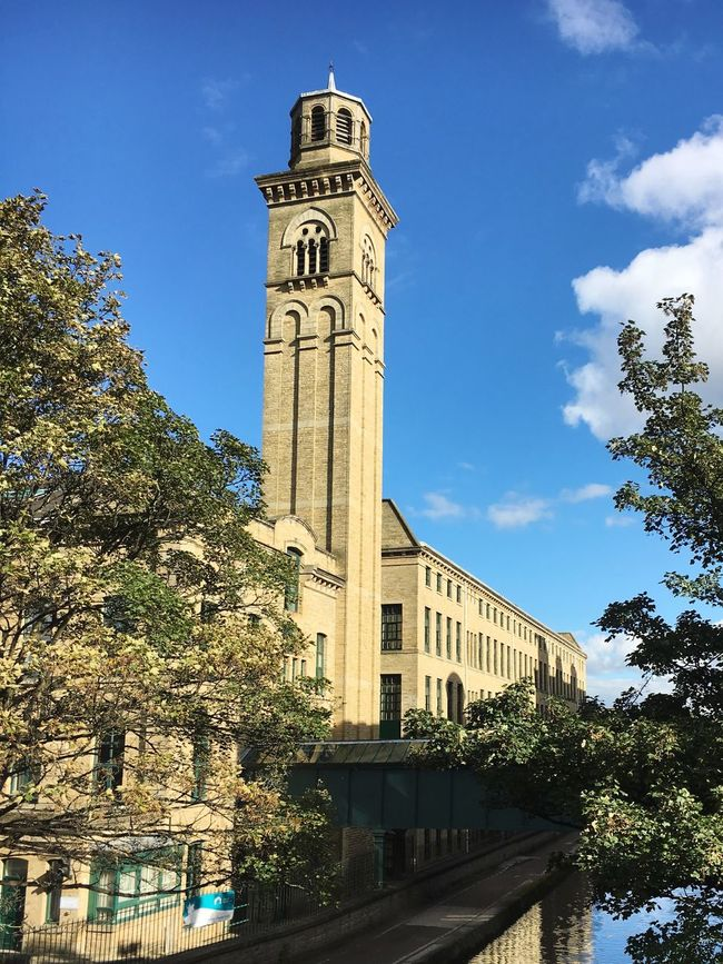 Architecture Built Structure Tree Building Exterior Tower Tall - High Low Angle View Guidance Clock Tower Tall Blue History Sky Outdoors Local Landmark Day Dark Satanic Mills Architectural Column Place Of Worship Historic Building