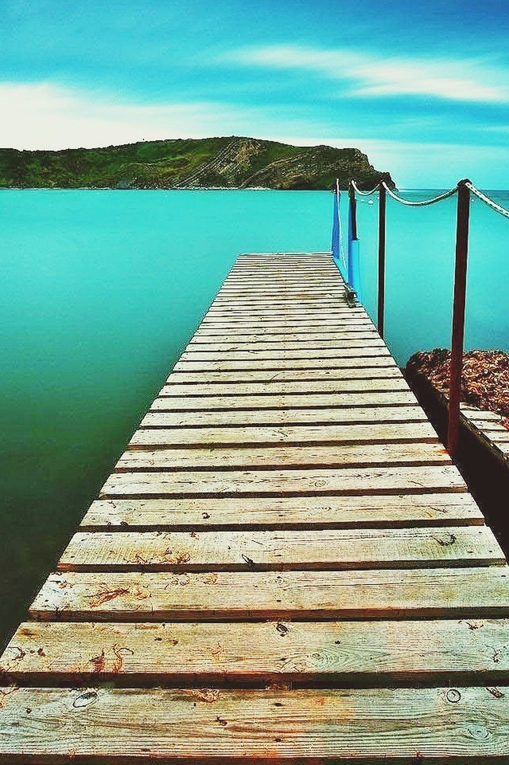 sky, water, wood - material, sea, tranquility, tranquil scene, pier, blue, scenics, nature, beauty in nature, wooden, railing, cloud - sky, wood, cloud, boardwalk, lake, built structure, jetty