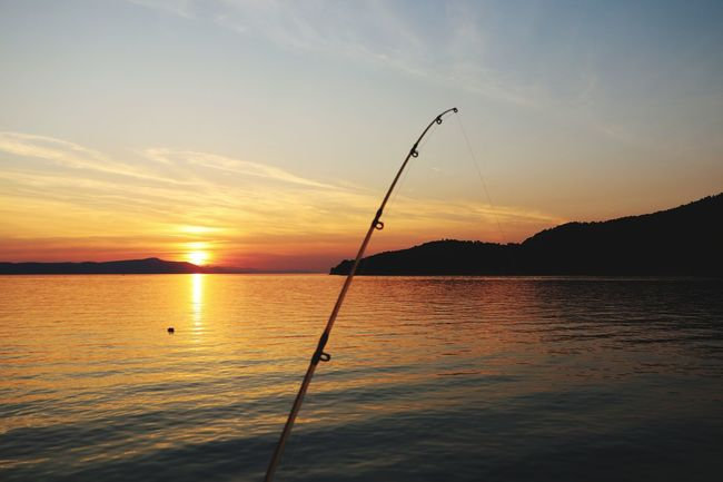 Sunset Water Sea Reflection Fishing Sky Sun Nature Beauty In Nature Scenics Cloud - Sky Tranquility Sunlight No People Outdoors Horizon Over Water Fishing Tackle Nautical Vessel Day