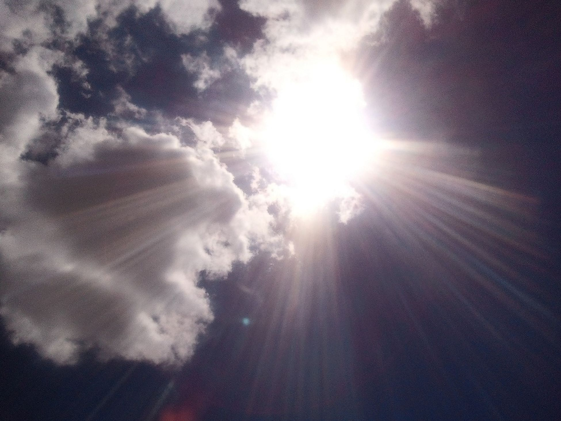 sun, sunbeam, sunlight, sky, lens flare, cloud - sky, bright, beauty in nature, tranquility, nature, scenics, low angle view, sunny, tranquil scene, cloud, outdoors, day, no people, idyllic, cloudy