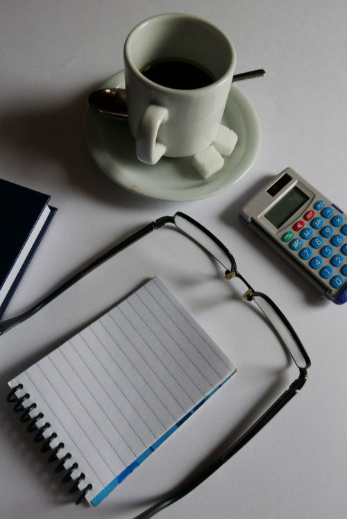 Simplicity White Background Eyeglasses  Notebook Cup Of Coffee Sugar Calculator Working Home Working Desk