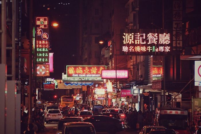 Illuminated Architecture Text Night Communication Building Exterior Advertisement City Neon Built Structure Car Large Group Of People Outdoors Travel Destinations Street City Street Real People Nightlife Crowd