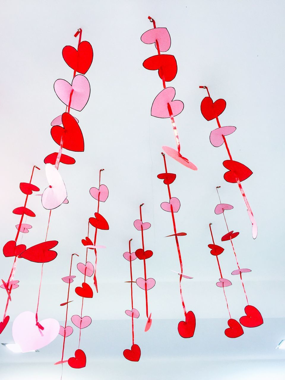 Low Angle View Of Paper Hearts Hanging From Ceiling