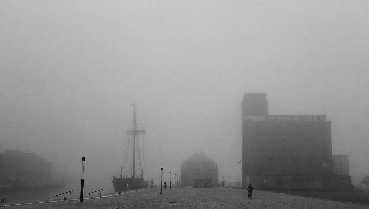 fog, weather, foggy, tourism, water, tourist, travel destinations, sea, tranquility, sky, tranquil scene, vacations, outdoors, tall - high, day, atmosphere, scenics, nature, waterfront, harbor, mist