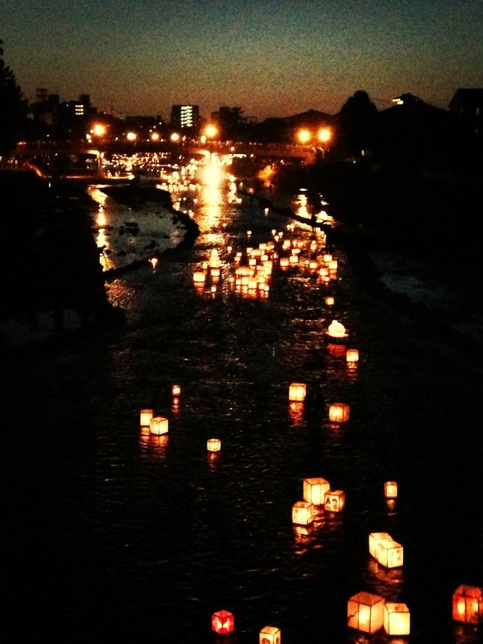 Ceremony In Which Paper Lanterns Are Floated Down A River
