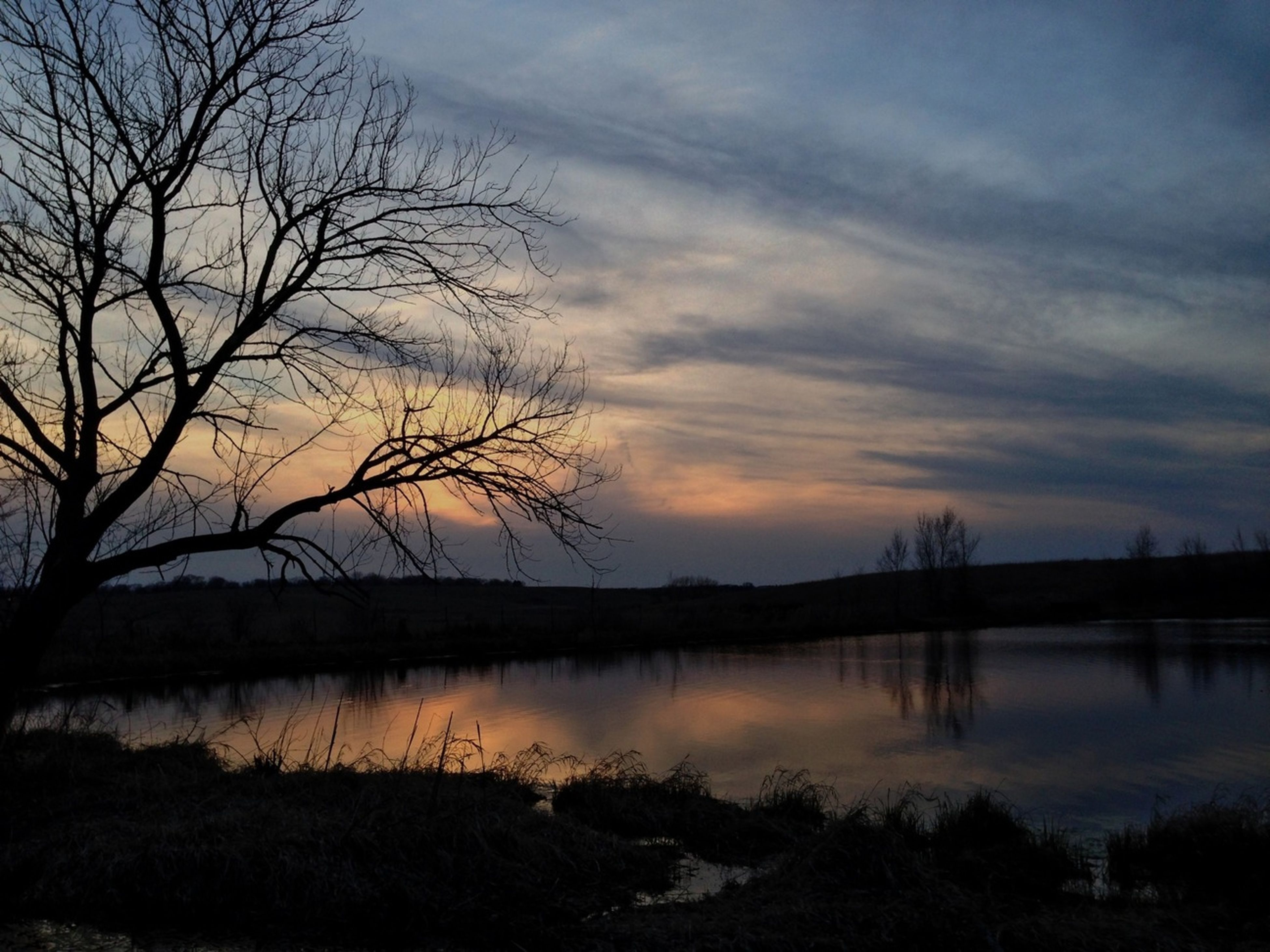 sunset, tranquil scene, tranquility, silhouette, water, sky, scenics, lake, bare tree, reflection, beauty in nature, tree, cloud - sky, nature, idyllic, cloud, dusk, calm, non-urban scene, river