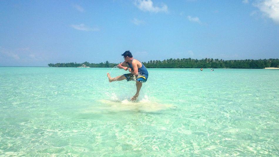 Jump shot over the water. Enjoying The Sun Beating The Heat