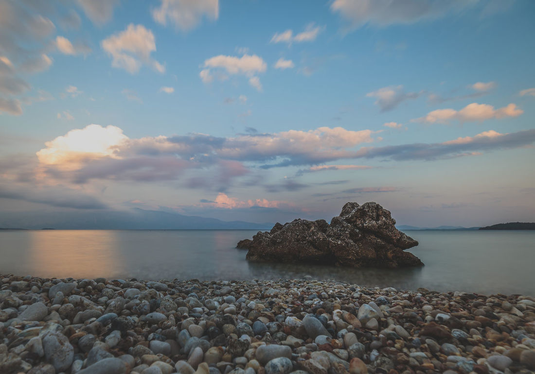 Beach Beauty In Nature Cloud - Sky Day Horizon Over Water Nature No People Outdoors Pebble Rock - Object Sea Sky Sunset Tranquil Scene Water