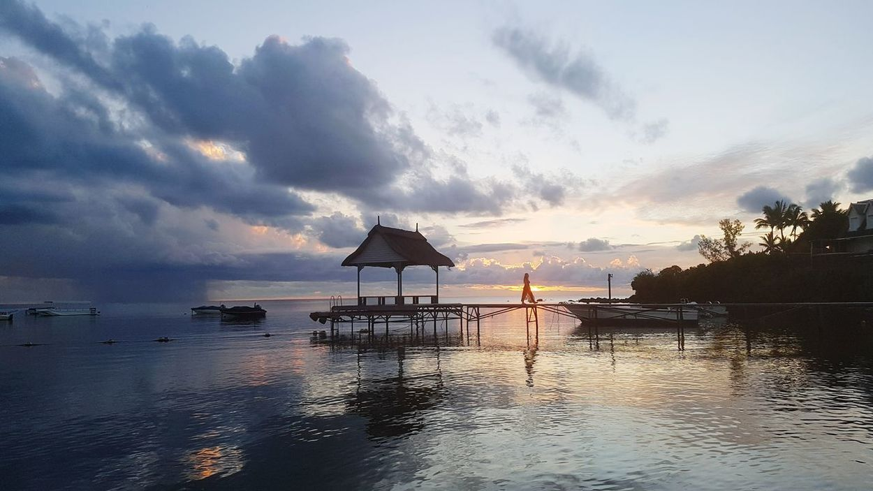 Holiday in Mauritius Reflection Water Nature Travel Cloud - Sky Sea Sunset Tranquility No People Beauty In Nature Scenics Outdoors Architecture Floating On Water Sky Day Woman Jetty, Pier Mauritius Island Beach Life Mauritiusexplored Mauritius Creole Travel My Year My View