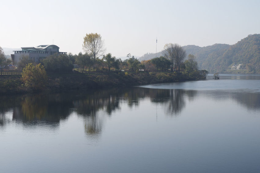 View of Daecheong Lake in Daejeon, Chungnam, South Korea Autumn Daecheong Dam Daecheong Lak Daecheongho Architecture Autumn Lake Beauty In Nature Building Exterior Built Structure Clear Sky Day Lake Lake View Lake Views Mountain Nature No People Outdoors Reflection Scenics Sky Tranquil Scene Tranquility Tree Water
