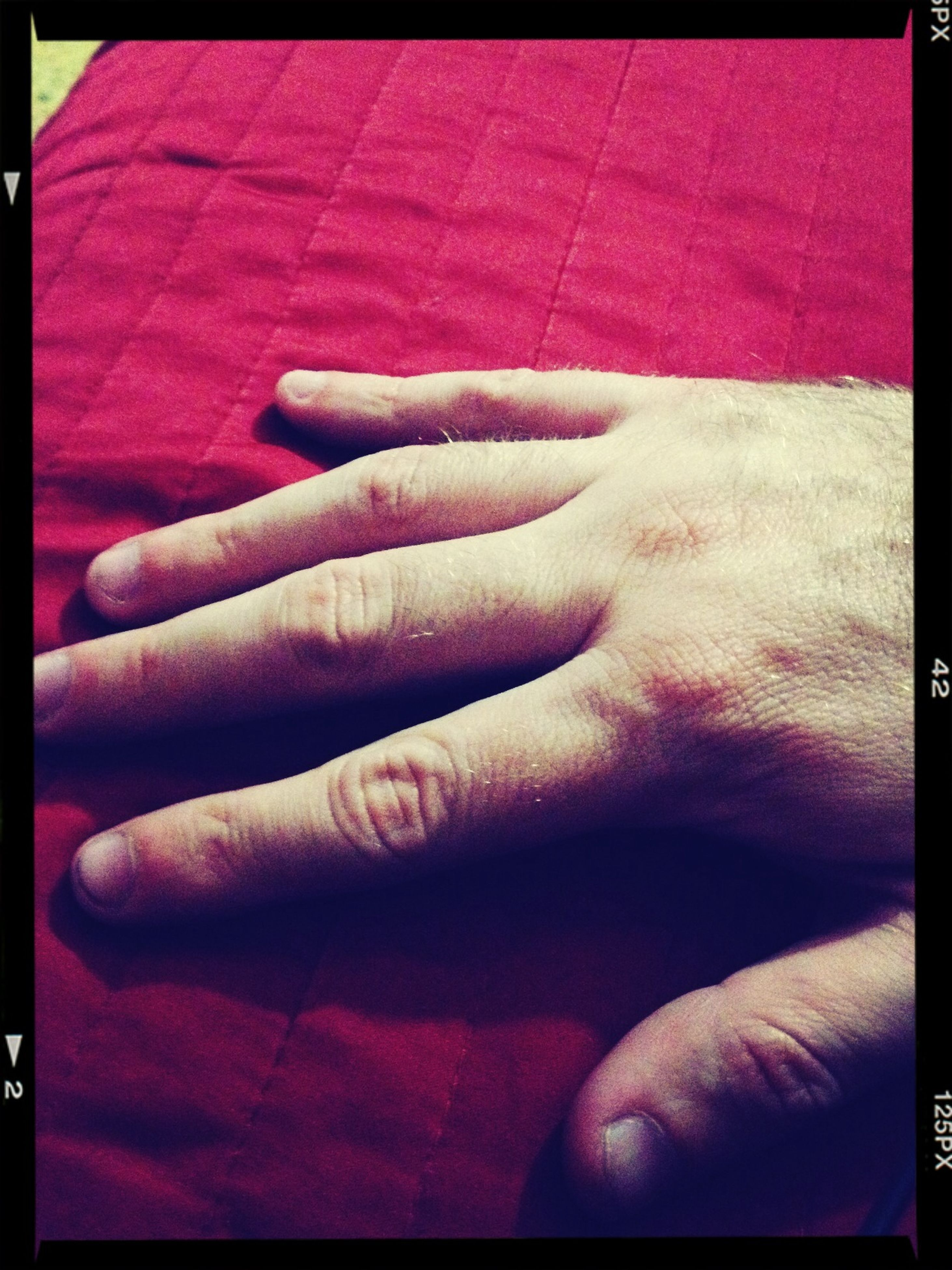 transfer print, auto post production filter, indoors, person, part of, close-up, human finger, lifestyles, cropped, red, unrecognizable person, men, bed, selective focus, holding