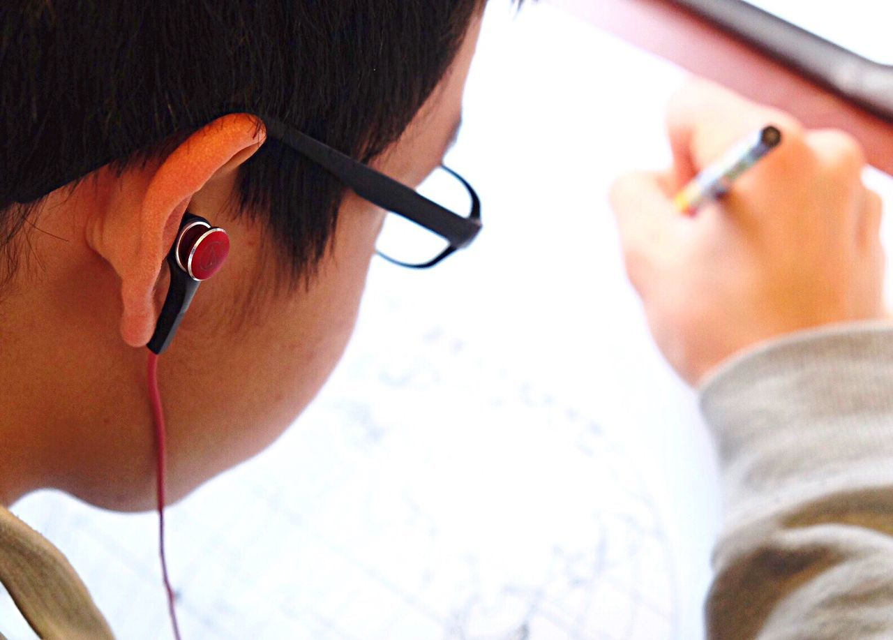 Doing homework Over The Shoulder View Drawing - Activity Young Adult Homework Homework Time Paperwork Paperworks Earphones Earphone EarPhonePlug Music Listening To Music Listen To Music Listening Listen Copy Space