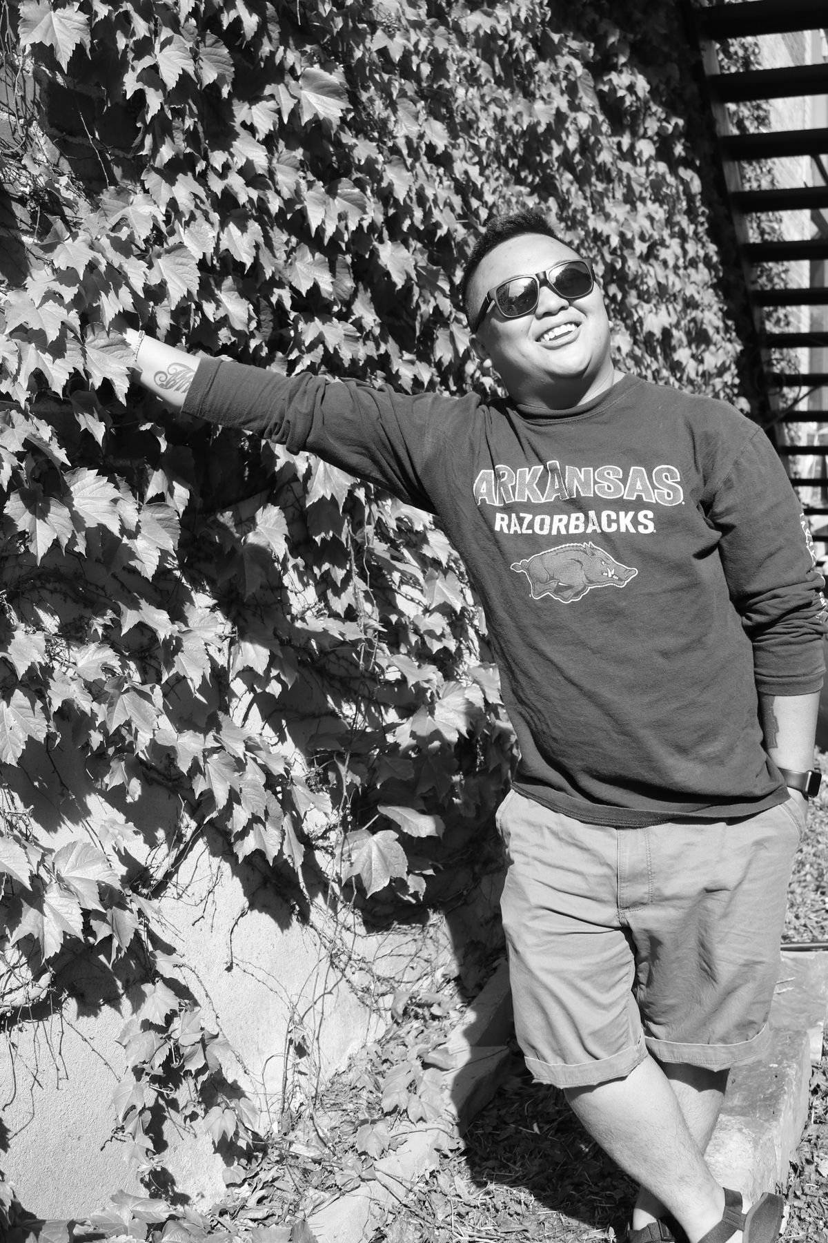 Downtown Siloam Springs, Arkansas One Person Front View Standing Real People Outdoors Day Young Adult Siloam Springs, Arkansas, USA Razorbacks  Smile Portrait Pictureoftheday Sunglasses Vines Vine Wall Black & White Siloam Springs