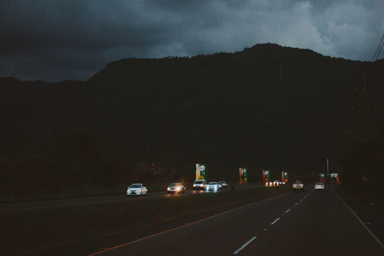 transportation, mountain, road, sky, car, land vehicle, the way forward, outdoors, illuminated, cloud - sky, no people, night, nature