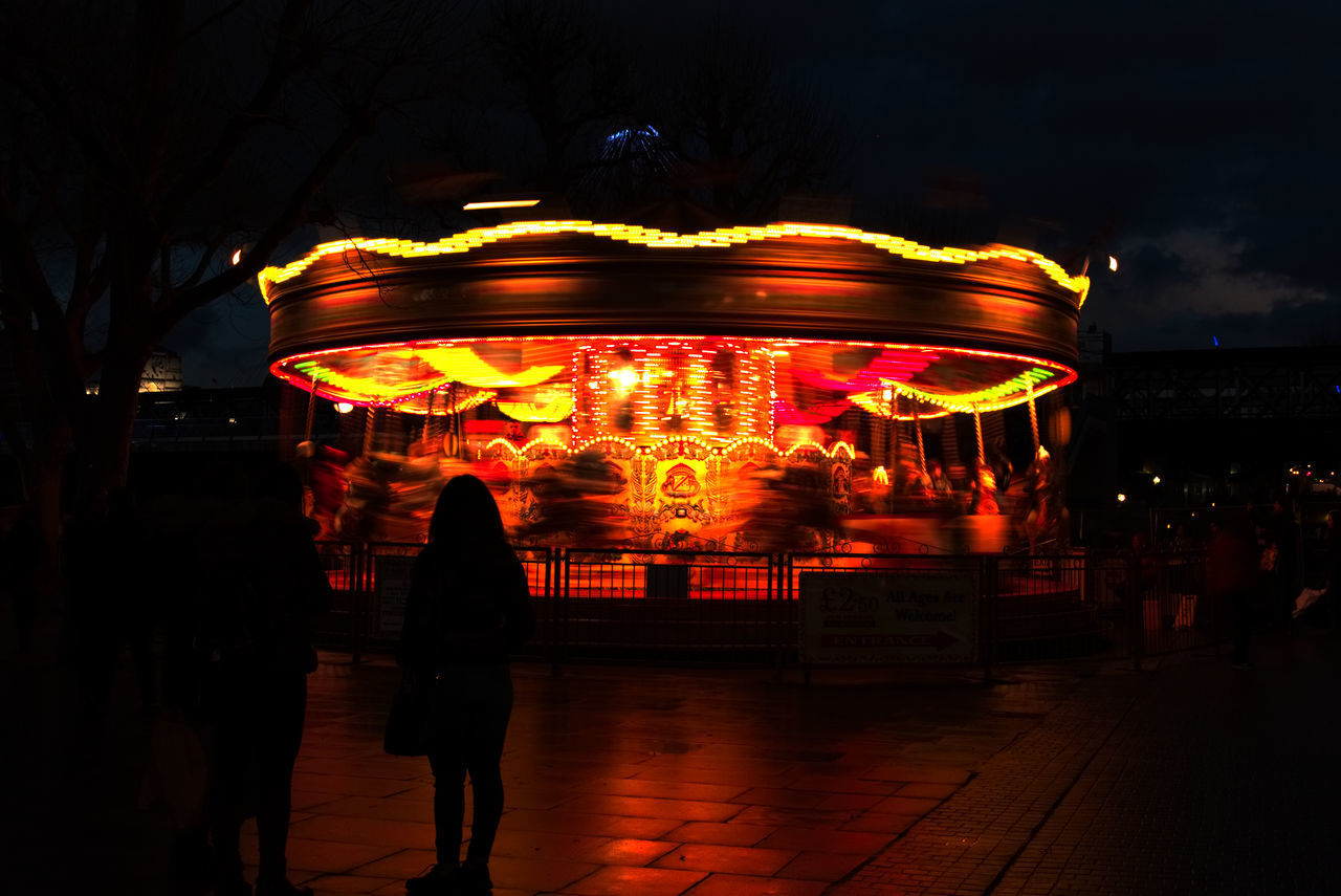 Adult Adults Only Amusement Park Ride Architecture Building Exterior Carousel Chinese Lantern Festival Chinese New Year City Cityscape Cultures Dark Illuminated Light Light And Shadow Light Effect London Long Exposure Neon Night Nightlife Outdoors People Sky Travel Destinations