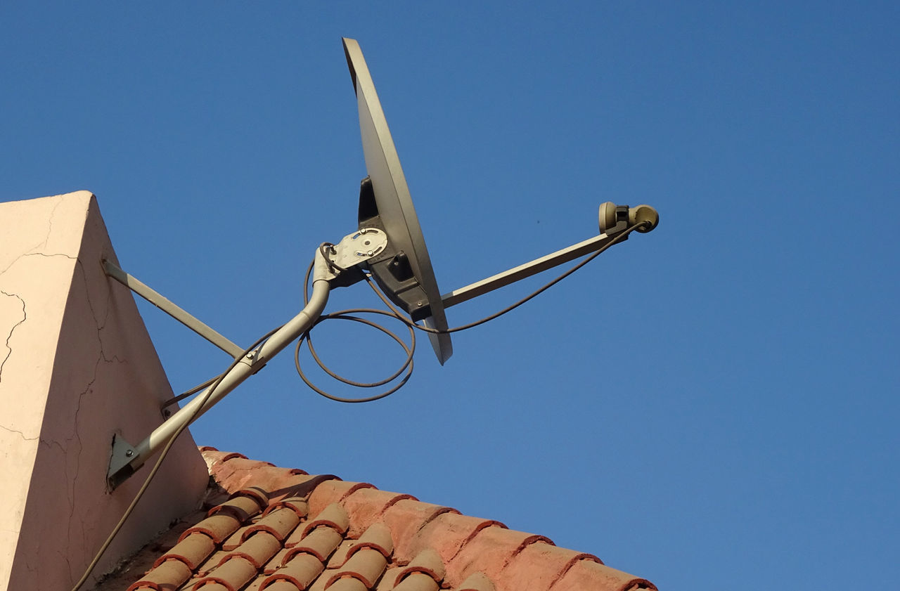 Satellite Dish Architecture Blue Bue Sky Built Structure Clear Sky Day Dish Anntenna DISH TV EyeEmNewHere Low Angle View No People Outdoors Rakeshtiwari Roof Tiles Rooftop Satellite Dish Sky Technology Tiles Wall Wall Mounted