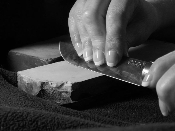 His rock. and his stone.. My husband teaching me the correct way to sharpen a blade. Human Hand One Person Close-up People Day Indoors  Rock Stone Knife Blade Handle Blackandwhite Grey Rock
