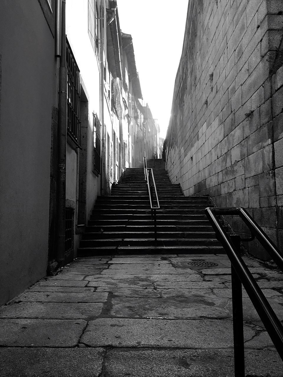 built structure, architecture, the way forward, building exterior, railing, steps, outdoors, city, steps and staircases, day, staircase, sky, no people