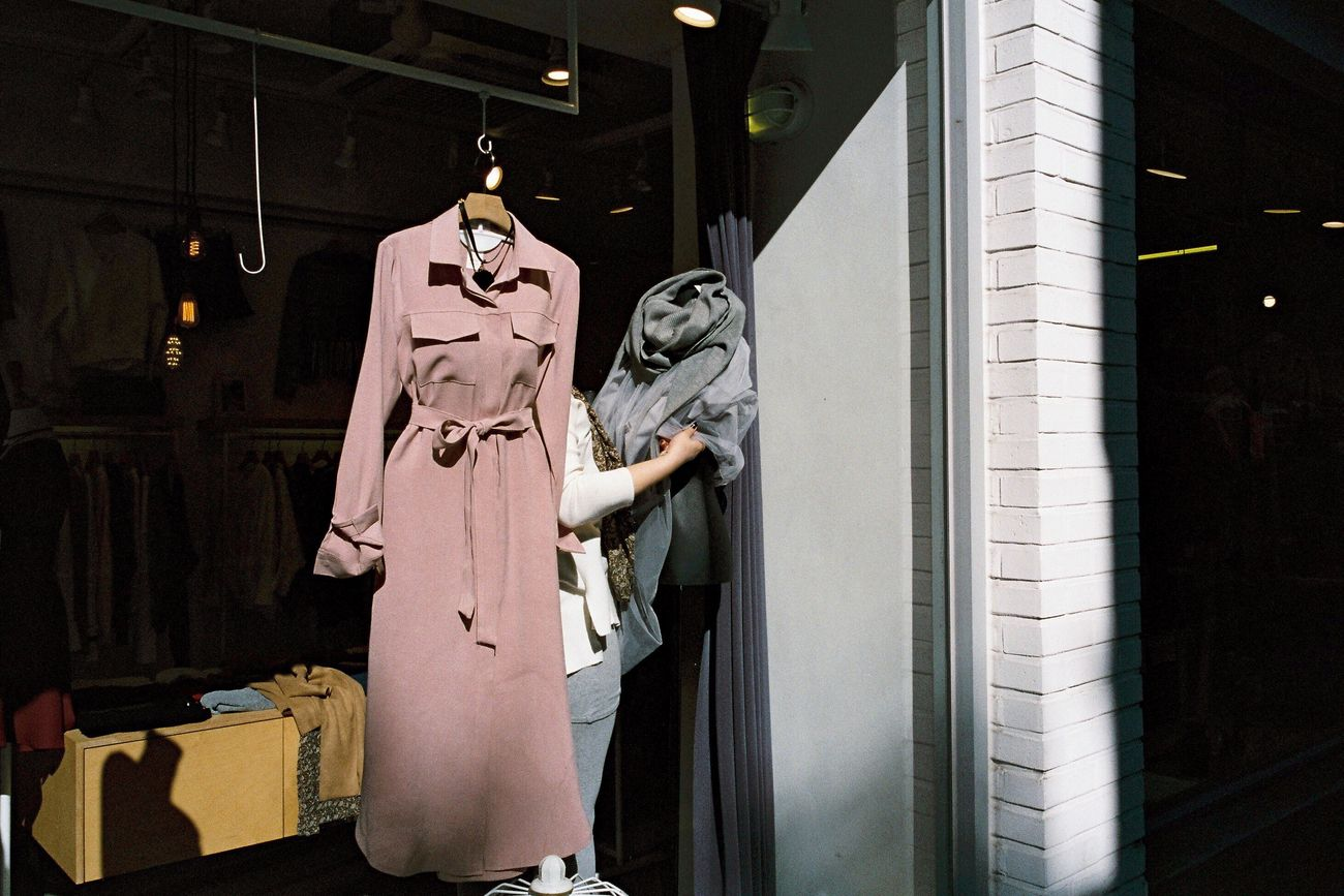 Fashion Boutique Street Photography Street Filmisnotdead Contax G2 Filmcamera Film Photography Arm Show Windows Looking Through Window Shop