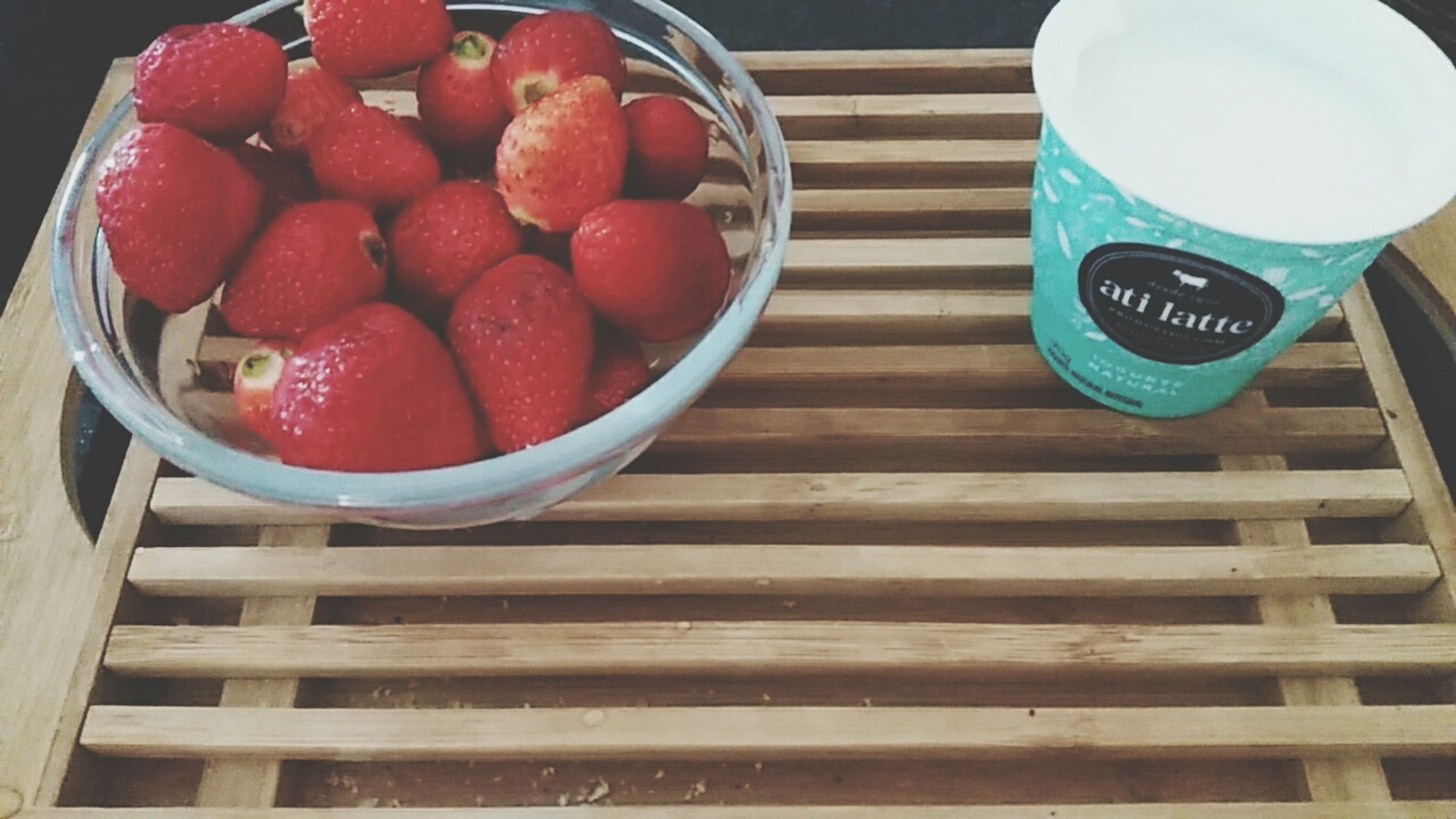 food and drink, red, food, freshness, indoors, fruit, high angle view, healthy eating, table, still life, bowl, strawberry, directly above, wood - material, container, no people, day, close-up, refreshment, plate