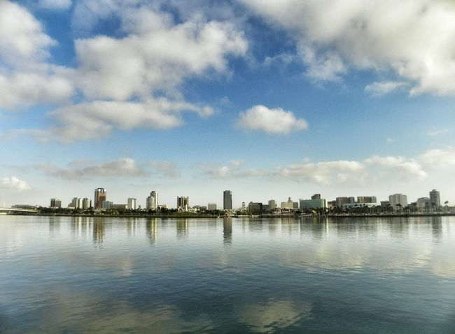 Architecture Building Exterior Built Structure City City Life Cityscape Cloud Cloud - Sky Cloudy Day Mid Distance Modern Nature No People Office Building Outdoors Rippled River Sky Skyline Skyscraper Tall - High Urban Skyline Water Waterfront