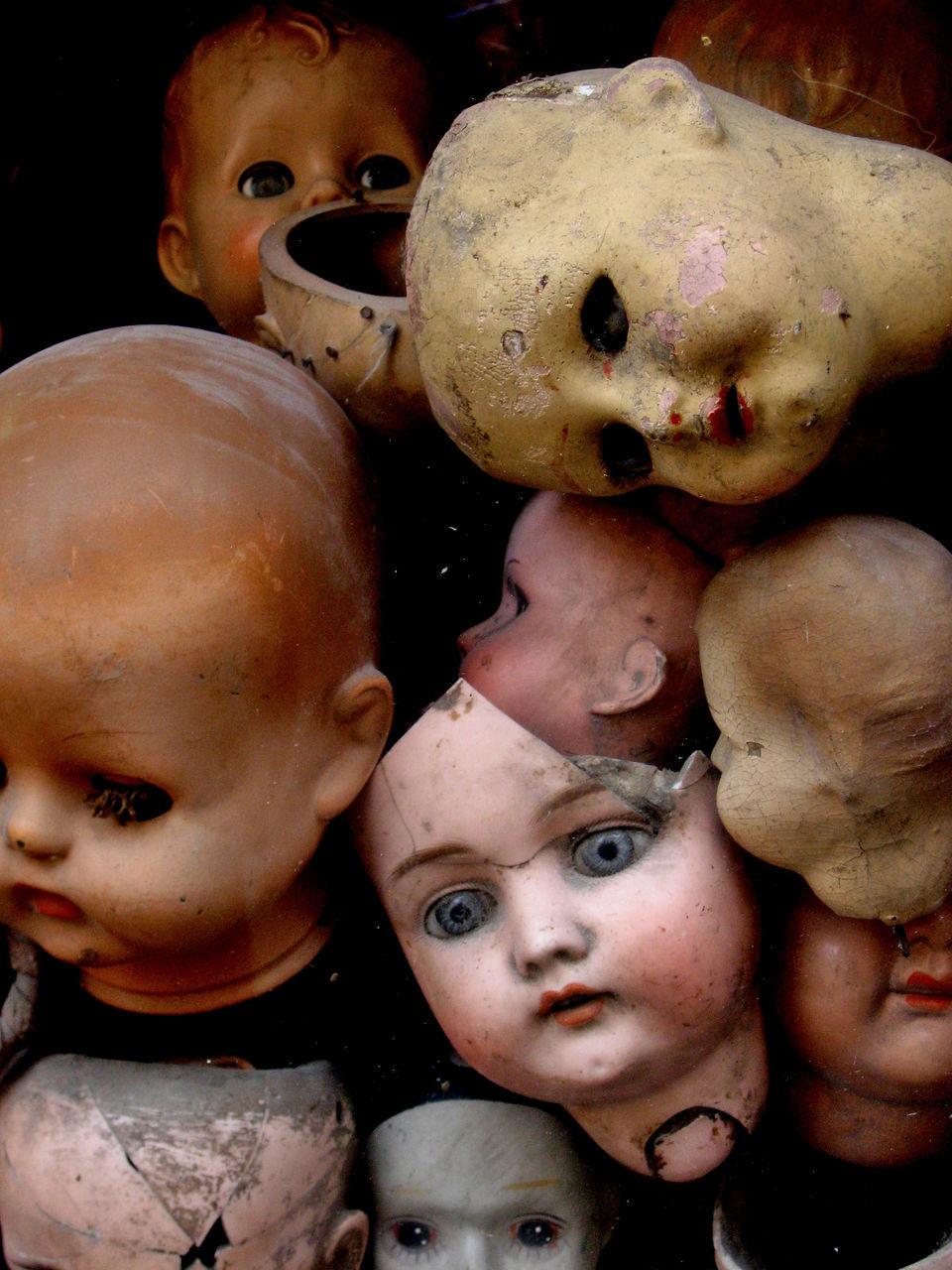 Close-Up Of Abandoned Dolls