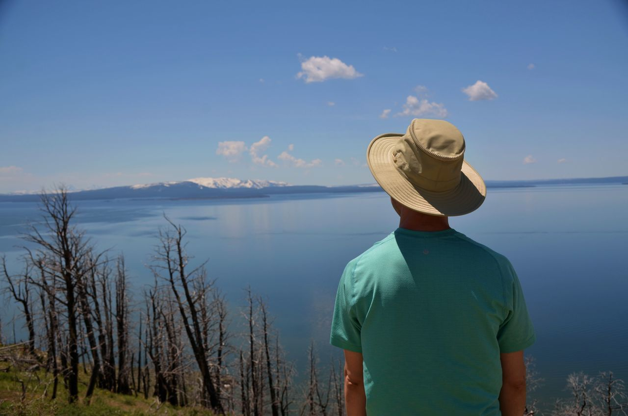 Finding Peace Hiking Adventures Lost In Thought Man Looking Out Over Lake Mountain Landscape Mountains And Lakes One Person Real People Rear View Taking It All In Yellowstone Lake The Street Photographer - 2017 EyeEm Awards The Great Outdoors - 2017 EyeEm Awards Let's Go. Together.
