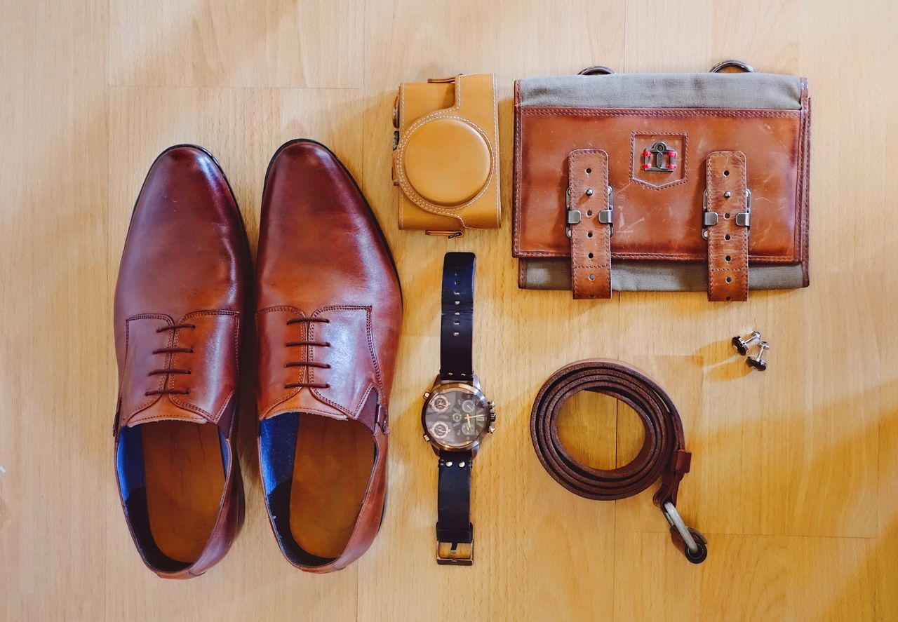 Brown fashion accessories for man Directly Above Table Fashion Brown Textured  Surface No People Wood - Material Shoes Wallet Watch Color Belt  Top Perspective View Layout Man Accesories Wear