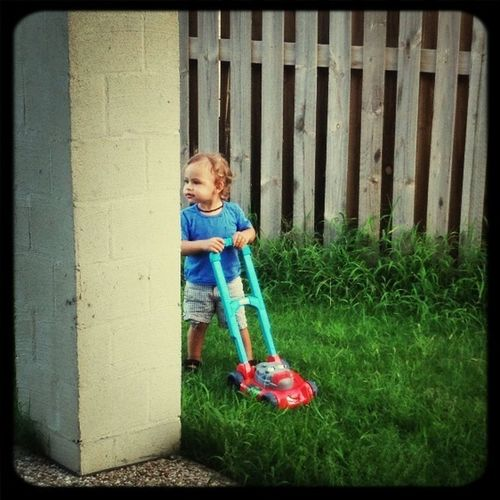 Mason Mowing Our Jungle Of A Backyard :)