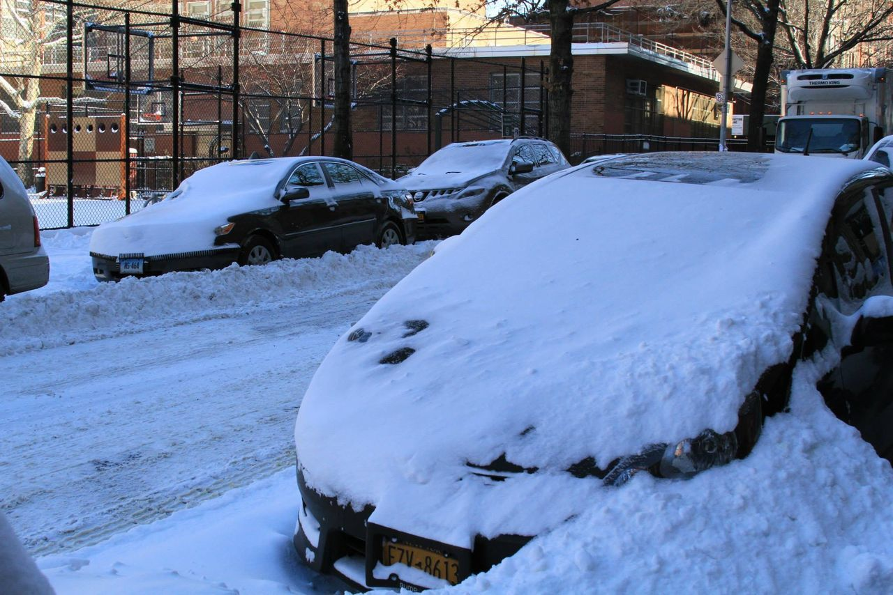 Cars Parked On Snow Covered Street
