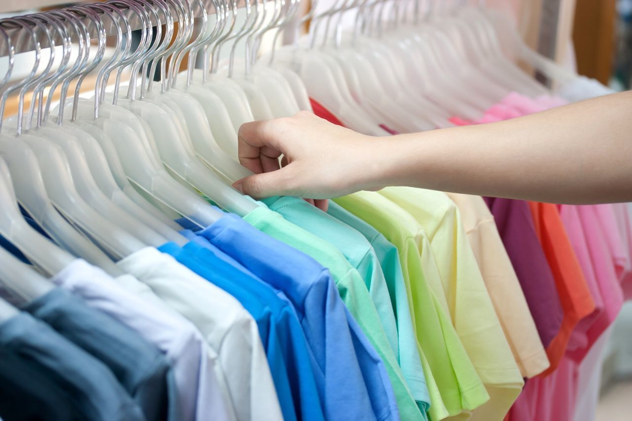 Choice Retail  Variation Store Fashion Clothes Rack One Person Abundance Coathanger In A Row Indoors  Consumerism Business One Woman Only Adults Only Multi Colored Large Group Of Objects Boutique Shelf People Colorful Multicolor Shouse Cloth Shirt