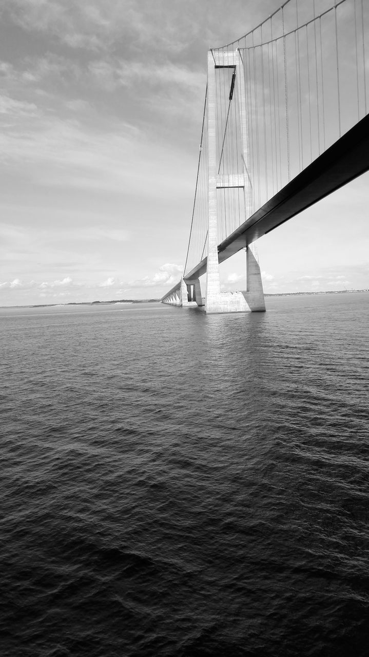 water, sky, connection, bridge - man made structure, suspension bridge, transportation, architecture, no people, waterfront, sea, built structure, outdoors, day, cloud - sky, nature, scenics, beauty in nature