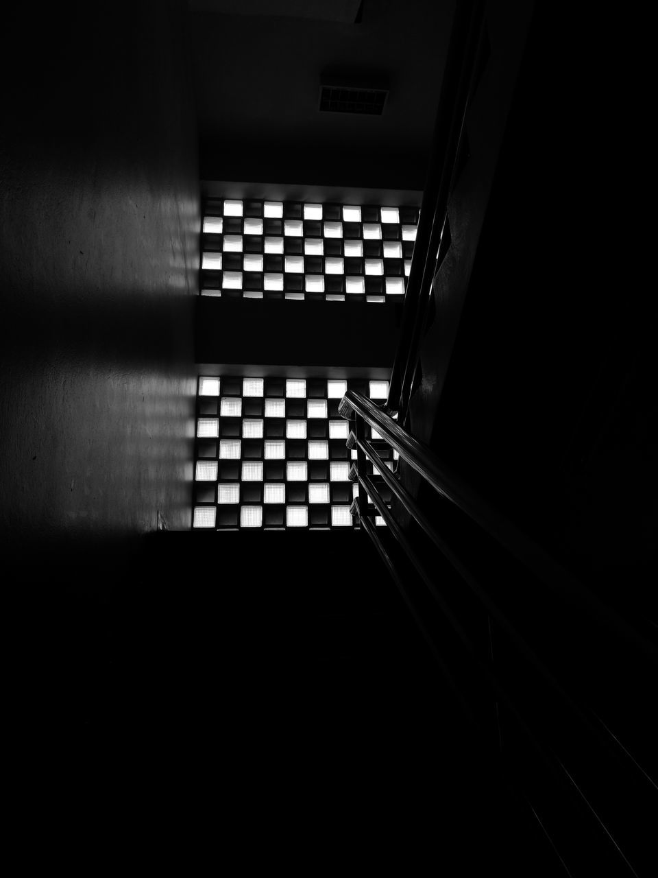 staircase, indoors, steps and staircases, steps, in a row, railing, architecture, no people, built structure, stairs, hand rail, illuminated, day
