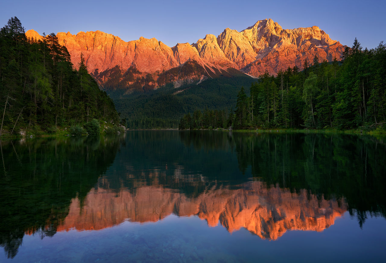 Zugspitze is the highest mountain in Germany. this photo was taken at sunset. Alps Beauty In Nature Calm Deutschland Eibsee Europe German German Alps Germany Golden Hour Lake Landscape Mountain Natural Nature Panorama Peak Reflection Scenics Summer Tranquility Travel Trees View Zugspitze The Great Outdoors - 2017 EyeEm Awards