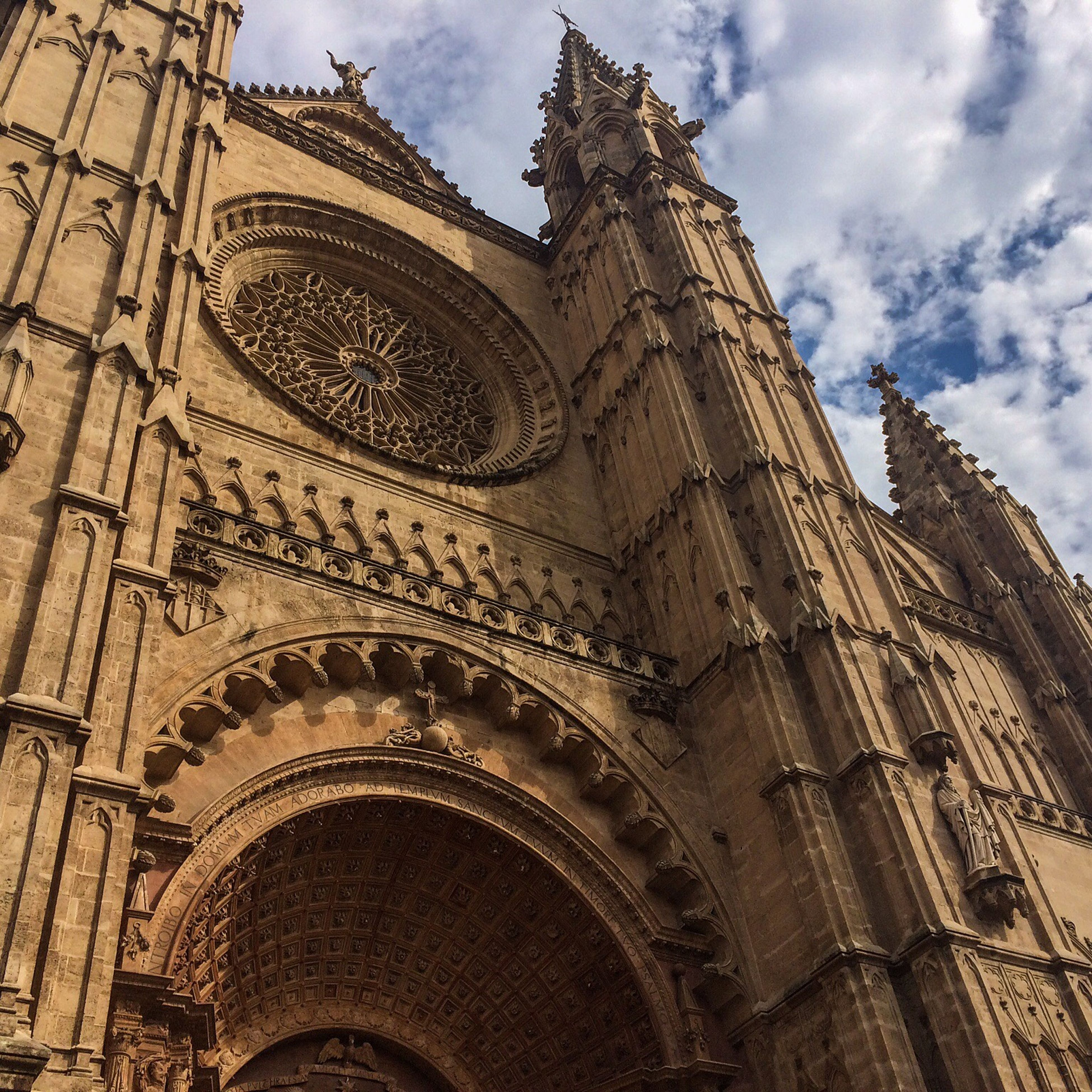 architecture, built structure, low angle view, place of worship, religion, building exterior, spirituality, famous place, sky, church, cathedral, travel destinations, history, tourism, travel, international landmark, cloud - sky, arch