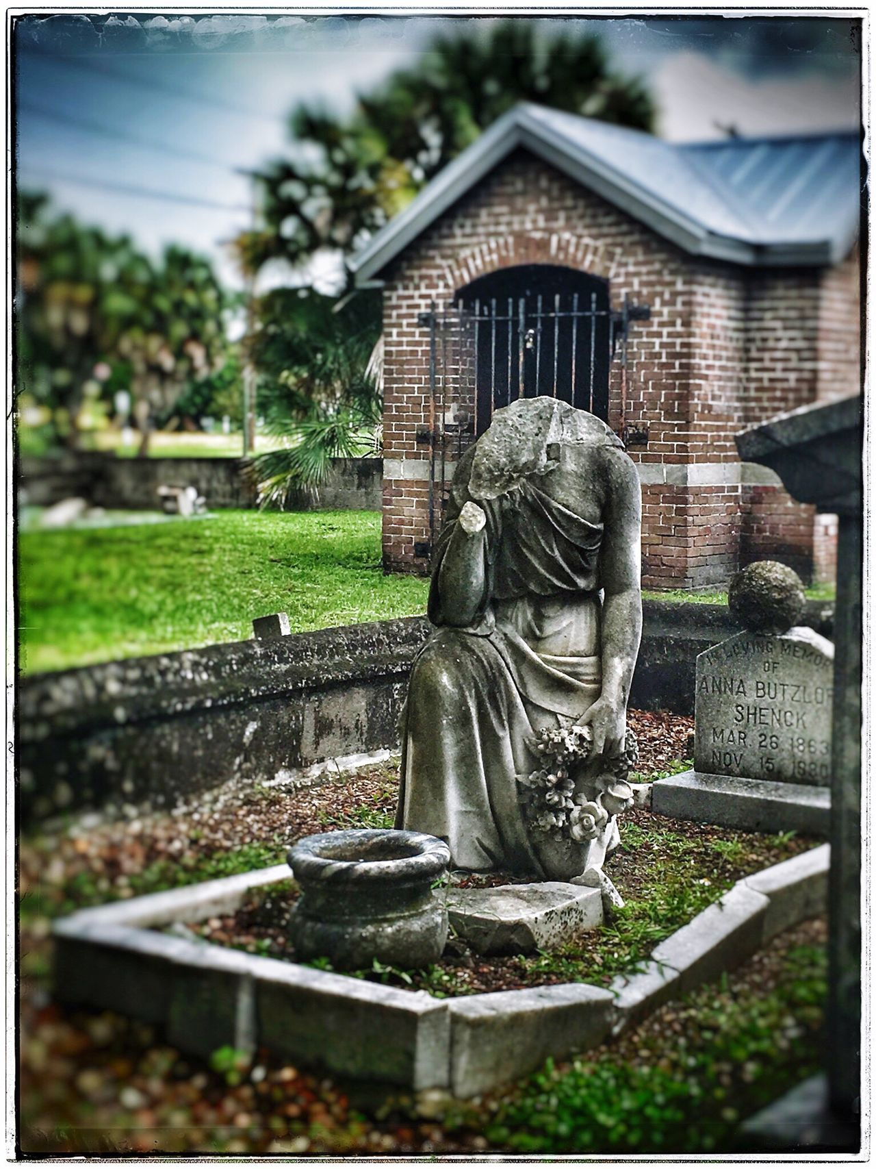 She's lost her head. Spooky Cemetery Photography Rainy Day