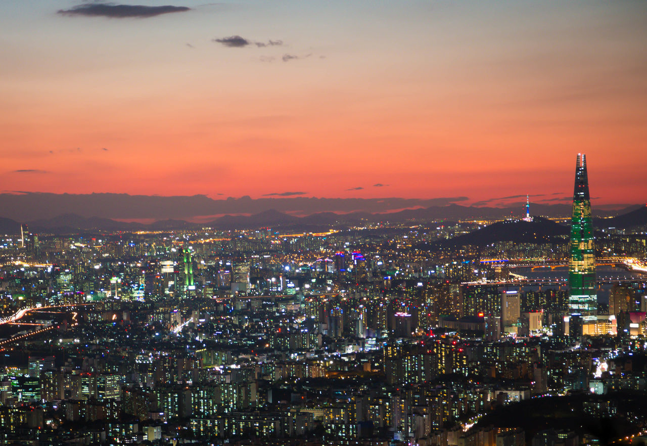 cityscape, architecture, city, building exterior, illuminated, built structure, no people, skyscraper, sunset, sky, travel destinations, modern, night, outdoors, nature