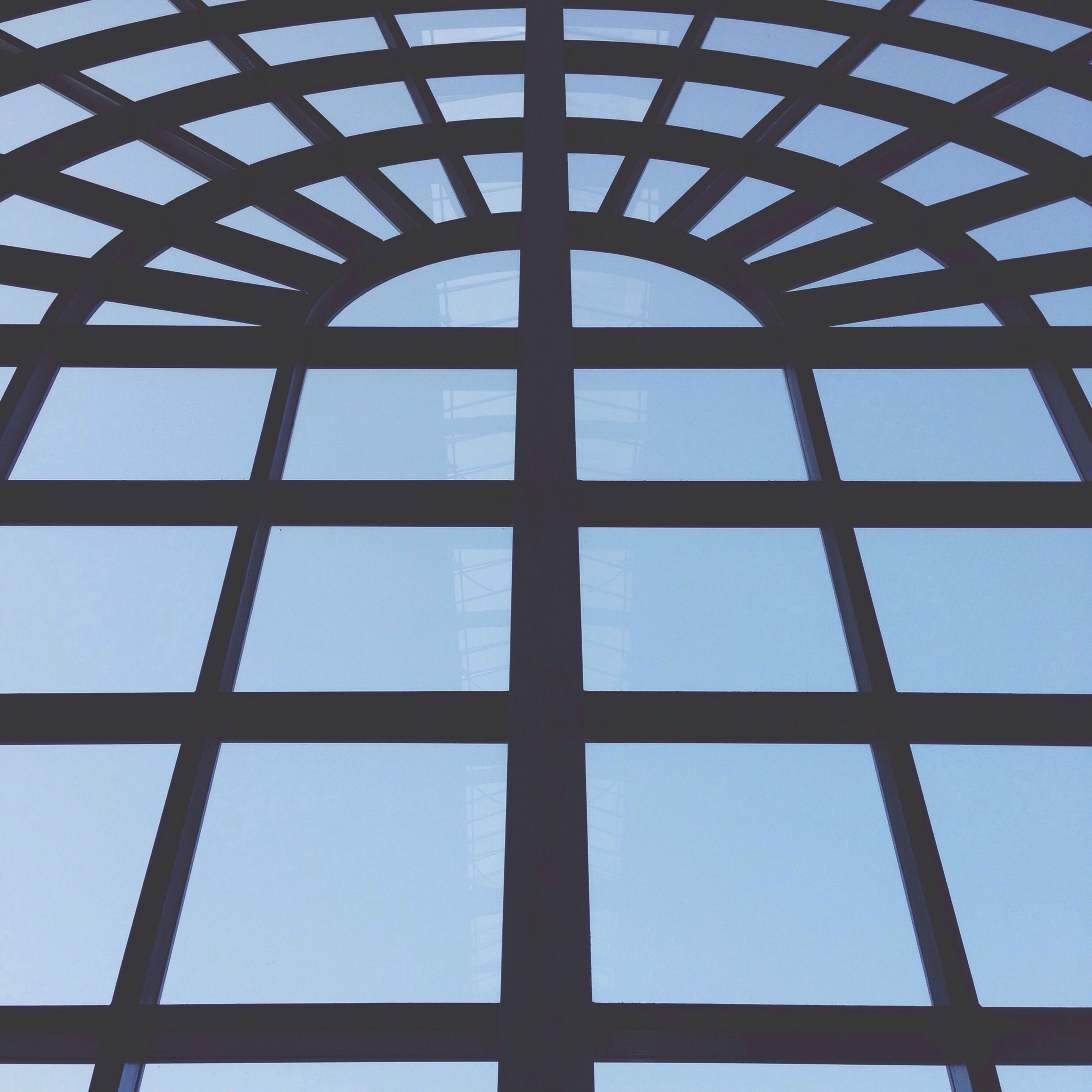 architecture, low angle view, built structure, glass - material, pattern, geometric shape, indoors, backgrounds, full frame, transparent, sky, blue, window, modern, reflection, day, clear sky, building exterior, no people, glass