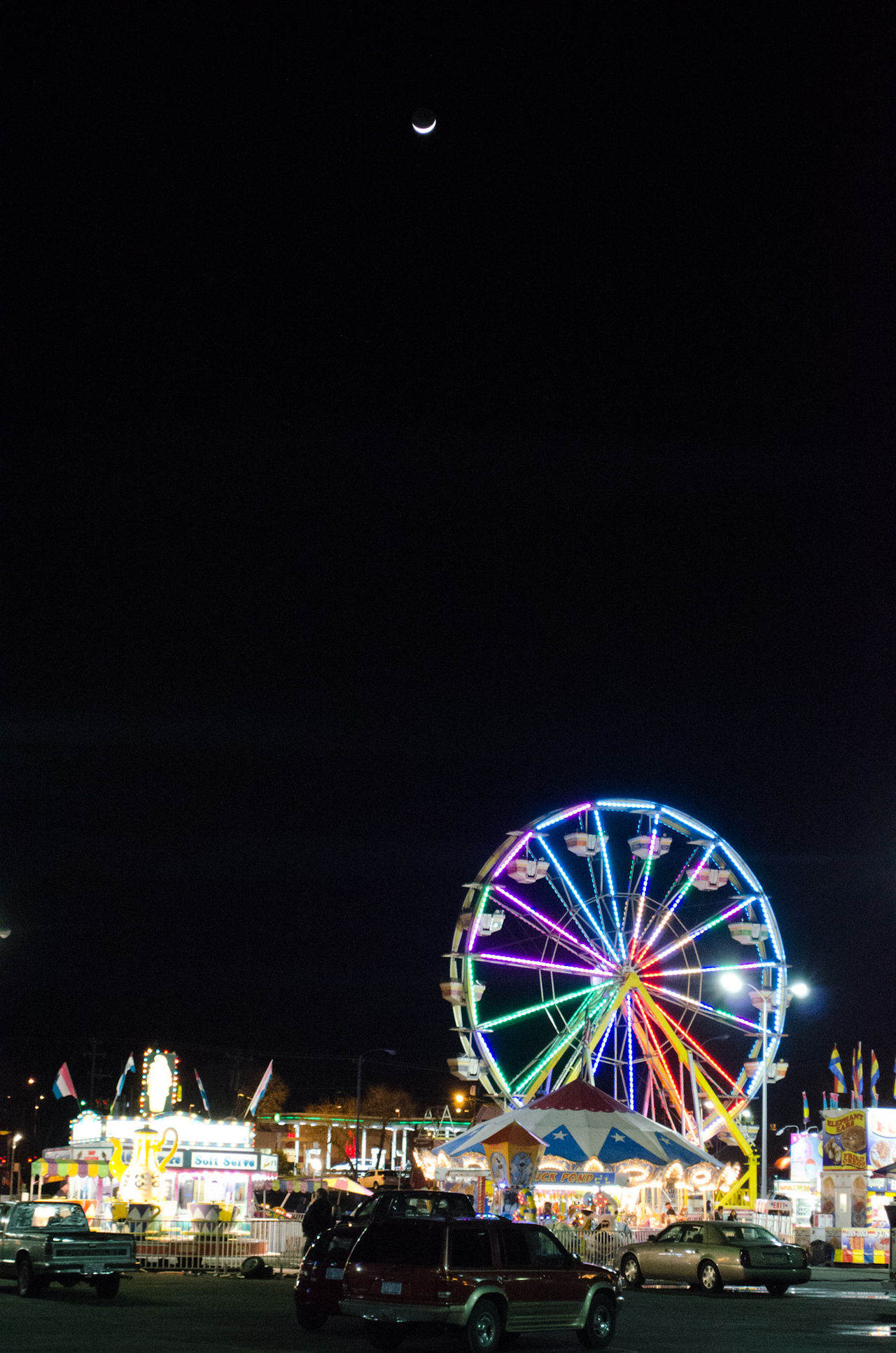 The Fair is in town ::s:: Amusement Park Amusement Park Ride Architecture Arts Culture And Entertainment Building Exterior Built Structure Copy Space Ferris Wheel Illuminated Multi Colored Nature Night No People Outdoors Sky First Eyeem Photo