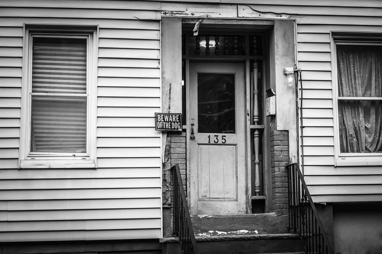 building exterior, closed, communication, architecture, text, built structure, door, shutter, window, outdoors, no people, day