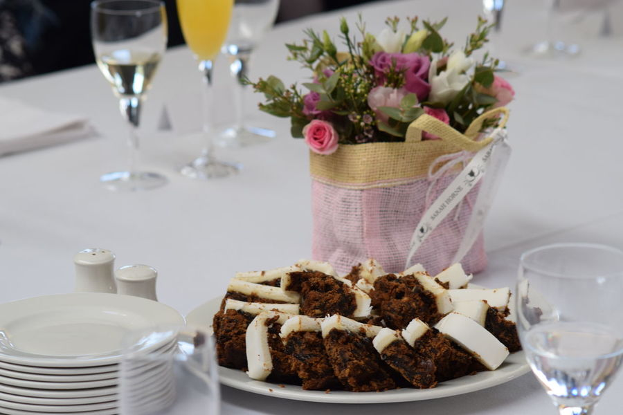 Close-up Focus On Foreground Food Freshness Indulgence Ready-to-eat Refreshment Restaurant Selective Focus Served Serving Size Still Life Wedding Centrepiece Wedding Photography Decor Champagne Glass Plant Nature Petal Flower Beauty In Nature Wedding Day Wedding Cake Cut Cake