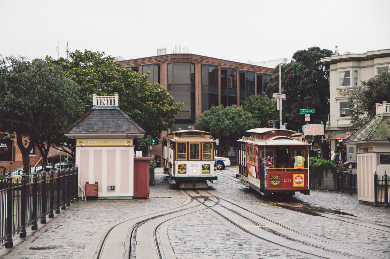 Architecture Building Exterior Built Structure Cable Car City City Day Mode Of Transport No People Outdoors Public Transportation Rail Transportation Railroad Track Rainy Sky Tram Transportation Tree