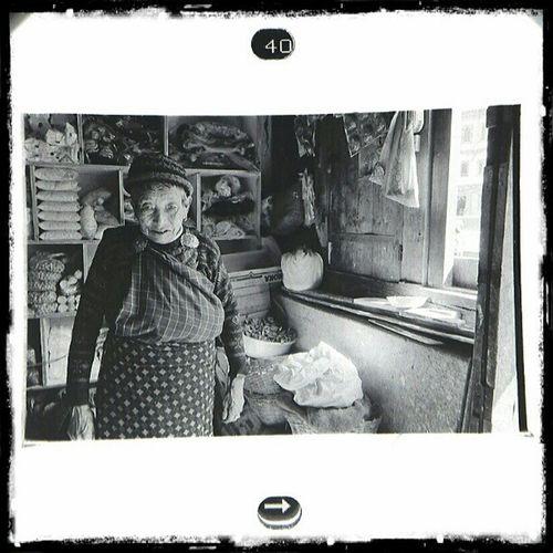 Store Keeper | HAA , Bhutan . 2012. | Fujifilm Neopan400 blackandwhite negative film viewed through loupe and sgs3. Leica m6 trielmar at 35mm. portrait environmentalportrait.